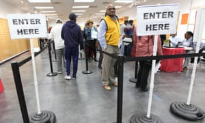 Georgia voters line up during early voting at a polling location in Decatur, Georgia on 22 October.