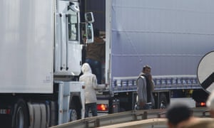 Migrants trying to board UK bound lorries on the main road into Calais ferry port