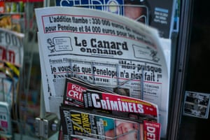An issue of Le Canard Enchaîné is displayed among other newspapers in a kiosk in Paris.
