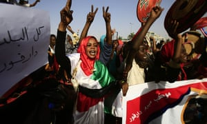 Sudanese protesters chant slogans as they gather near the military headquarters in Khartoum on 27 April.