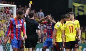 Wilfried Zaha reacts to being shown the yellow card for simulation by referee Chris Kavanagh.