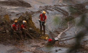 Rescue workers search for victims after the Samarco dam disaster