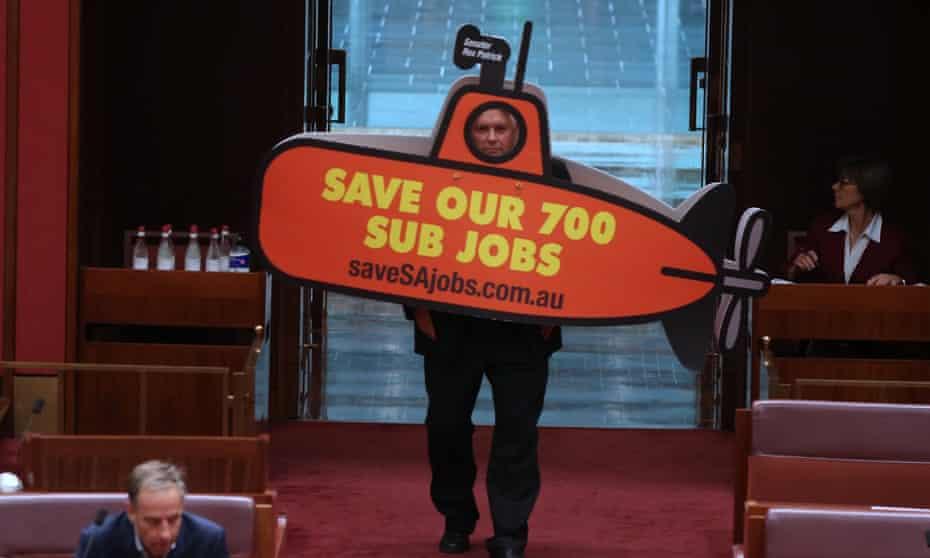 Patrick enters the Senate in a submarine costume
