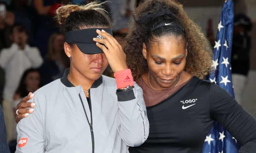 Serena Williams puts her arm around Naomi Osaka