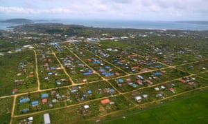 This photo taken on 15 March by CARE Australia shows an aerial photo of damage caused by cyclone Pam on the outskirts of the Vanuatu capital of Port Vila.