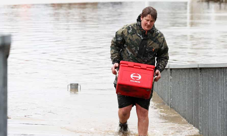 A man removes property from his business in Weza lane, Kumeu as heavy rain causes extensive flooding and destruction on August 31, 2021 in Auckland, New Zealand.