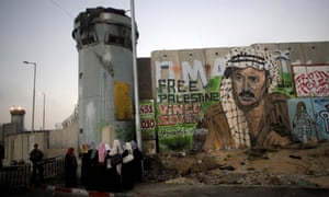 Palestinian women wait at the Qalandiya checkpoint between Jerusalem and Ramallah, 2010