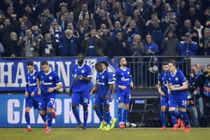 Schalke midfielder Nabil Bentaleb in the center celebrates with his teammates after he scored the first goal of his team.