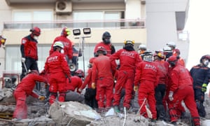 A rescue team at work on a collapsed building in the Turkish city of Izmir on Sunday morning.