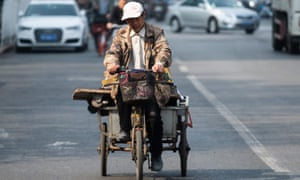 A tricycle rider on a street in Beijing, China