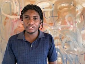 Gresham Tapiwa Nyaude, di depan pekerjaan yang belum selesai.