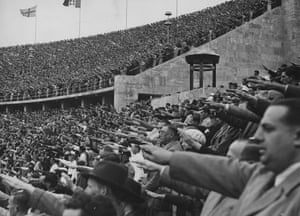 Crowded ranks in the Olympic stadium during a victory ceremony, August 1936, Berlin.
