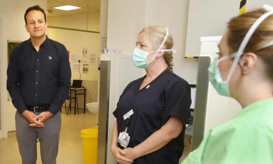The Irish prime minister, Leo Varadkar, left, speaks to employees during a visit to a coronavirus community assessment hub at Dublin City University on 29 April
