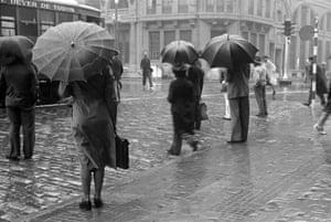 Umbrellas along Avenida São João