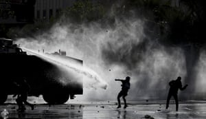 Police deploy a water cannon during an anti-government protest in Santiago, Chile