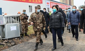 Chinese vice premier Sun Chunlan on a visit to Wuhan on 2 February. Videos appeared to show her being heckled on her return visit on Thursday with residents shouting 'fake, fake', 'it's all fake'.