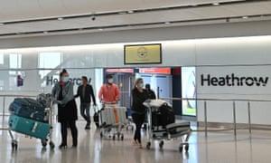 Passengers wearing personal protective equipmentat Heathrow airport