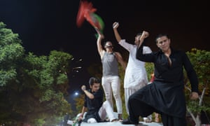 Supporters of Imran Khan, who is head of the Pakistan Tehreek-e-Insaf party, celebrate on a street during general election in Islamabad