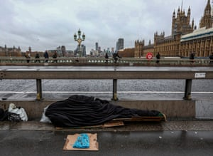 A homeless person on Westminster Bridge