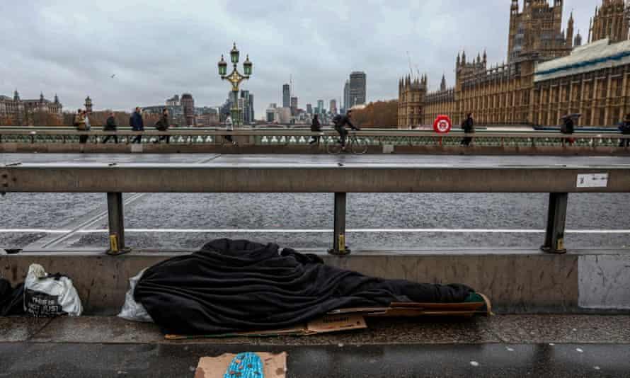 A rough sleeper on Westminster Bridge.