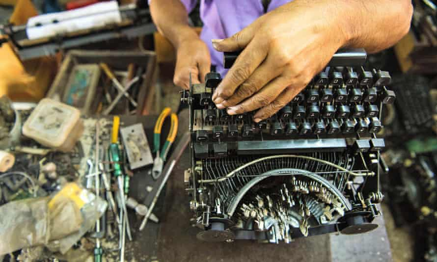 A technician repairs an old manual typewriter in Mumbai, Maharashtra, India.