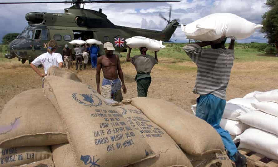 Workers load a British Puma helicopter with relief food in Mozambique. Photograph: AFP/ODD Andersen