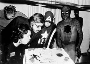 Stan Lee and his wife Joan blow out the candles on the Marvel Comics birthday cake at opening day ceremonies of the First Mighty Marvel Comic Book Convention, on 22 March 1975 in New York