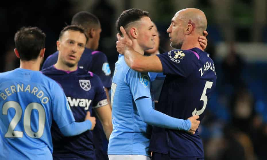 Phil Foden embraces former teammate Pablo Zabaleta at the final whistle.