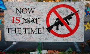 A sign hangs on a fence at Marjory Stoneman Douglas high school in Parkland, Florida, following the mass shooting there earlier this month.