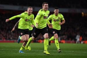 Sheffield United's John Fleck (center) celebrates after scoring a draw.