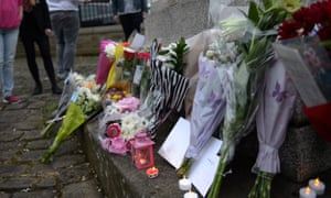 Flowers are laid at a statue to Joseph Priestly in Birstall