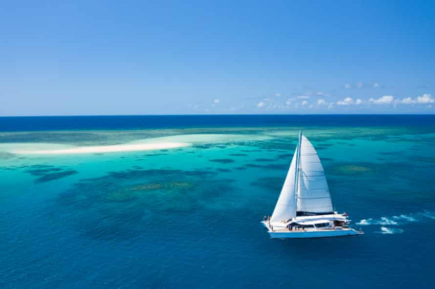 A sailboat tours the outer Great Barrier Reef