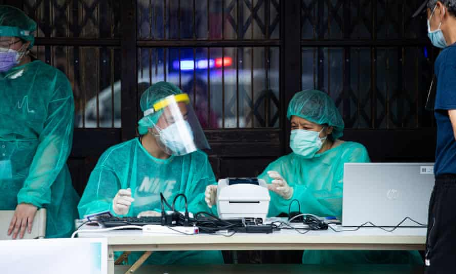 Taiwan Health Officials Set Up Rapid COVID-19 Test Stations Following The Outbreak, Taipei - 14 May 2021Mandatory Credit: Photo by Annabelle Chih/NurPhoto/REX/Shutterstock (11904243b) Medical staff at the rapid COVID-19 test station in Wanhua District following the outbreak in Taipei, Taiwan on 14 May, 2021. Taiwan Health Officials Set Up Rapid COVID-19 Test Stations Following The Outbreak, Taipei - 14 May 2021
