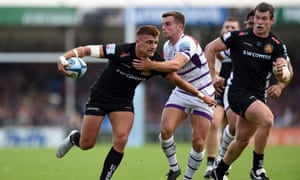 Henry Slade brushes past George Ford at Sandy Park.