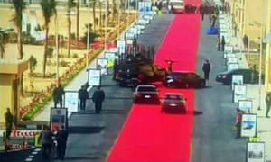 All the president's hem … the motorcade and rug on Egyptian state TV.