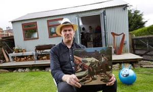 Artist Bedwyr Williams shows off his copy of Indiscreet by Sparks at his studio in Rhostryfan, North Wales.