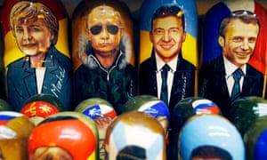Matryoshka dolls of the four leaders, Angela Merkel, Vladimir Putin, Volodymyr Zelensky and Emmanuel Macron on sale at a street market in St Petersburg.