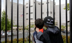 Javier Tapia, five, and his brother, Charlie Tapia, seven, originally from Mexico, stand outside a federal detention center holding migrant women on 9 June in Washington state.