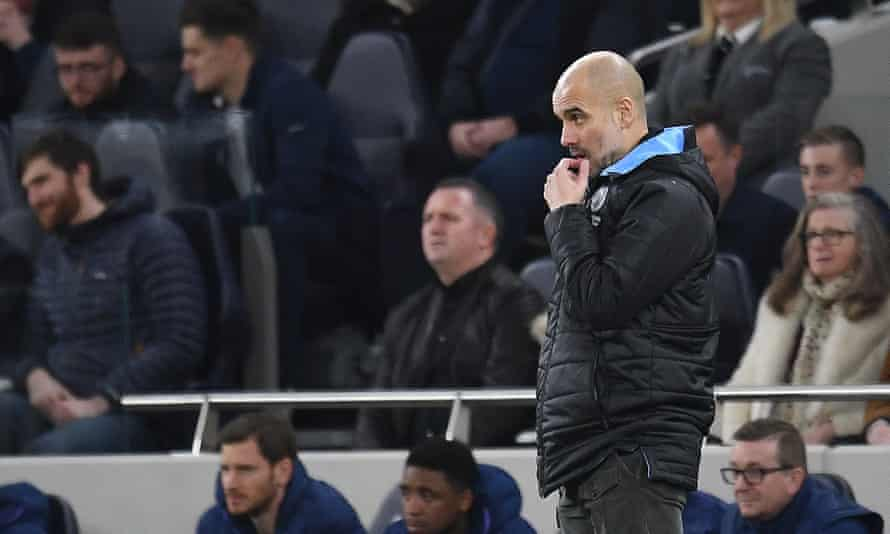 Pep Guardiola watches from the touchline at Tottenham