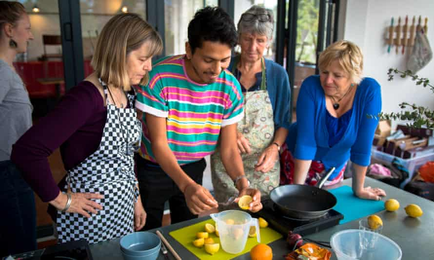 Customers picking up tips at an Argentinian cookery class given by the charity.