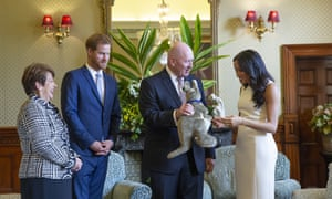 Australia's governor general Sir Peter Cosgrove (second right) and his wife Lady Cosgrove (left) present a toy kangaroo to Prince Harry and his wife Meghan, the Duchess of Sussex.