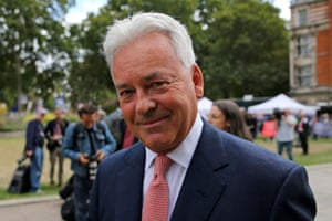 Alan Duncan walks through College Green, near the Houses of Parliament.