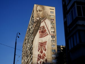 Some murals are less political in their imagery, such as this portrait of a girl in traditional Ukrainian clothing by Van Helten, which covers 18 storeys of a Soviet-era apartment block