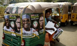 A rickshaw emblazoned with campaign posters for People's Democratic party election candidate Atiku Abubakar.