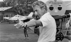 John Guillermin with megaphone, directing