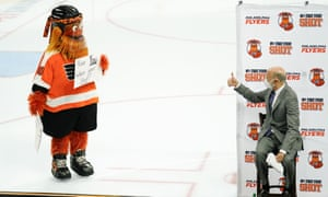 Governor Tom Wolf gives the thumbs up to Philadelphia Flyers' mascot, Gritty, during a news conference encouraging people to get the Covid-19 vaccine, in Philadelphia in the US.