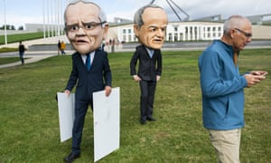 Protesters dressed as Scott Morrison and Bill Shorten at the anti-Adani rally in Canberra on Sunday