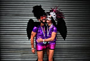 A gay couple embrace as they watch the Belfast Gay Pride march. The province is the only part of the United Kingdom which does not recognise same sex marriage
