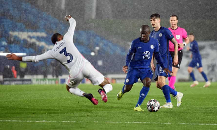 Chelsea's N'Golo Kanté is challenged by Eder Militão of Real Madrid at the Estadio Alfredo Di Stéfano