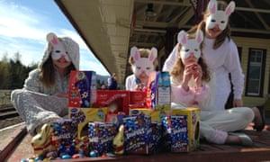 Children in bunny costumes on railway platform.